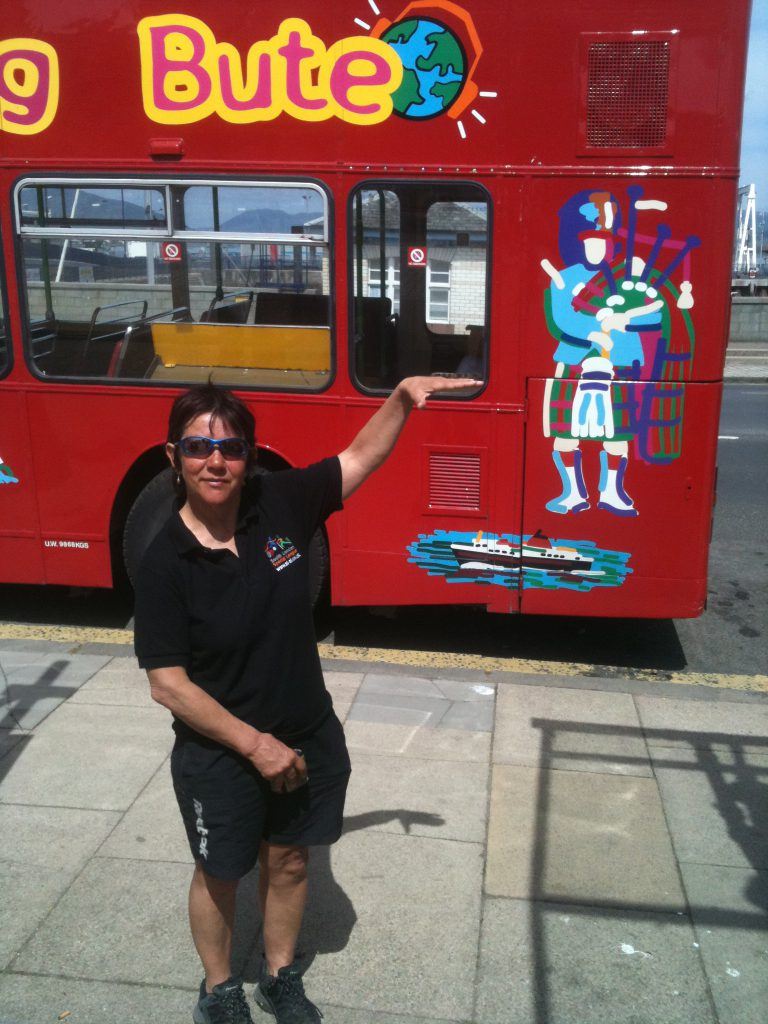 Sharon and a scottish bus complete with piper