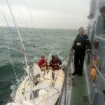 Sonata alongside navy vessel